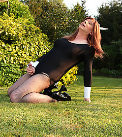 Cheeky Lucimay is dressed as a naughty bunny and playing outdoors